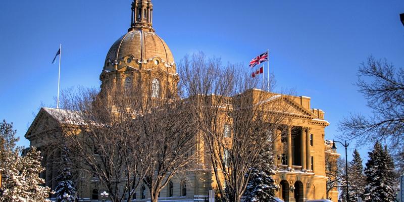 Balance Alberta's budget sooner—limit growth of debt interest costs