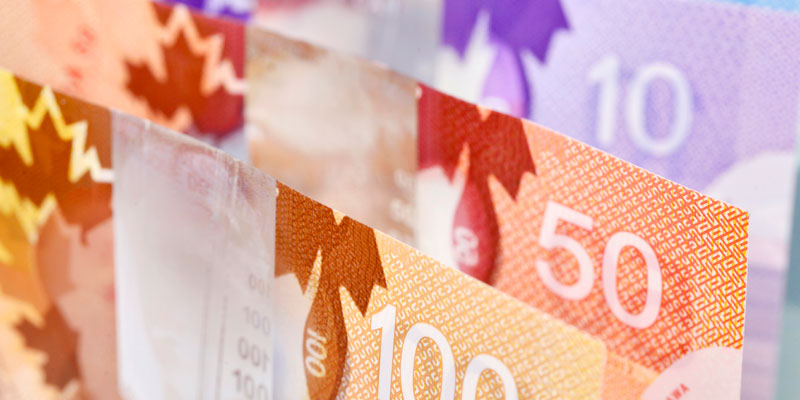 Ottawa reducing value of money and spending billions
