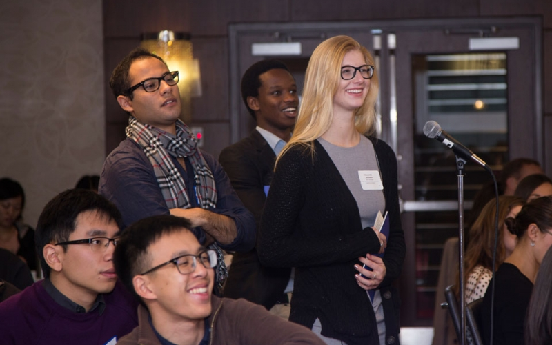 Students line up to ask questions following a presentation in Vancouver.