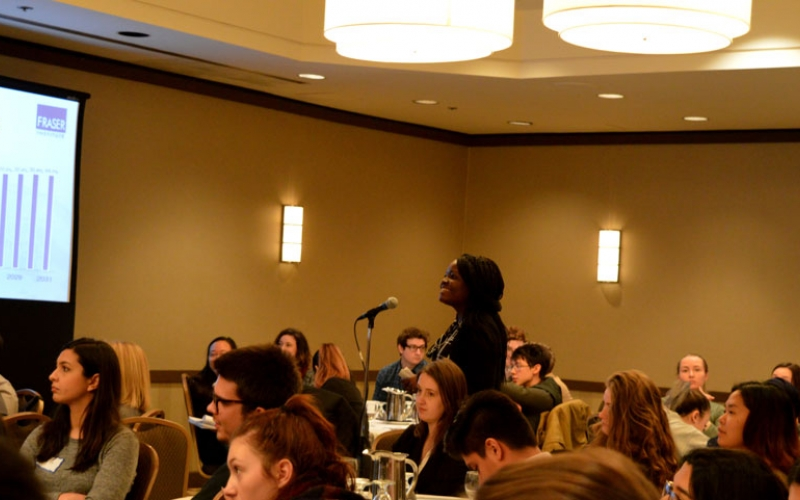A student poses a question to the speaker following a presentation in Toronto.