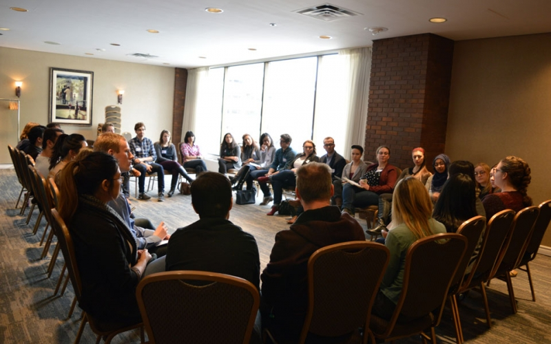 Students break out into a smaller discussion group following a presentation in Calgary.