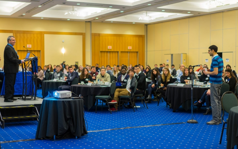 Speaker, Fred McMahon, takes a question from a student following his presentation in Vancouver.