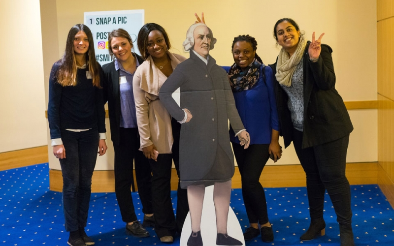 A group of students pose with Adam Smith, a prominent philosopher who laid the foundations of classical free market economic thinking, as part of the #SMITHSELFIE campaign.