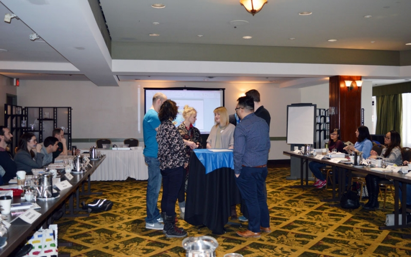Instructor Ninos Malek leads an activity that showcases the importance of property rights