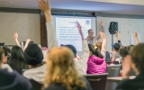 """Instructor Dirk Mateer  wins over the crowd with his lecture on everyday  """"incentives""""."""